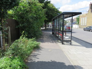 Bus stop, South side of the East end of Wick Road